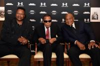 LOUISVILLE, KY - OCTOBER 01: Larry Holmes, Muhammad Ali, and George Foreman attends the Sports Illustrated Tribute to Muhammad Ali at The Muhammad Ali Center on October 1, 2015 in Louisville, Kentucky. (Photo by Stephen Cohen/Getty Images for Sports Illustrated)